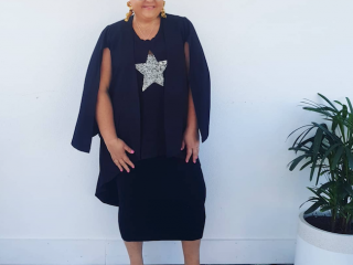 Jenni from Styling Curvy is looking fabulous in a black starry night tank from Taking Shape matched with a black skirt and animal print shoes.