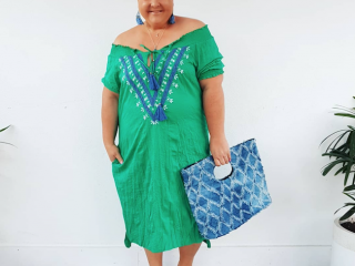 Jenni from Styling Curvy looking very beachy in a green dress and bag by Adrift.